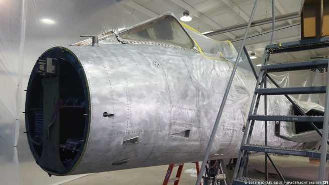 The stripped down fuselage of Neil Armstrong's Douglas F5D Skylancer aircraft undergoes restoration at Thomarios in Copley, Ohio. The cockpit instruments and ejection seat were removed to be restored by conservationists at the Intermuseum Conservation Association in Cleveland. Photo Credit: Michael Cole / Spaceflight Insider