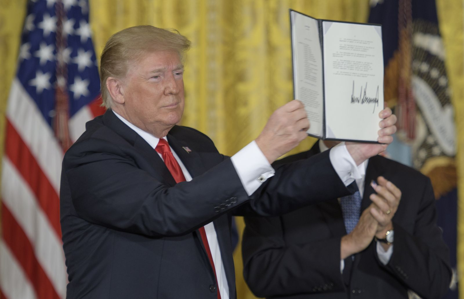 File photo: President Trump holds up the signed Space Policy Directive 3 during the June 18, 2018, meeting of the National Space Council. Space Policy Directive 4 was signed on Feb. 19, 2019, and calls for the establishment of a U.S. Space Force. Photo Credit: Bill Ingalls / NASA