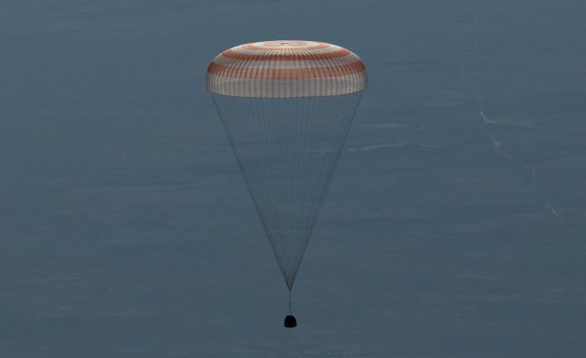 The Soyuz MS-07 spacecraft with Russian cosmonaut Anton Shkaplerov, NASA astronaut Scott Tingle and JAXA astronaut Norishige Kanai descends beneath the capsule's single large parachute. Photo Credit: Bill Ingalls / NASA