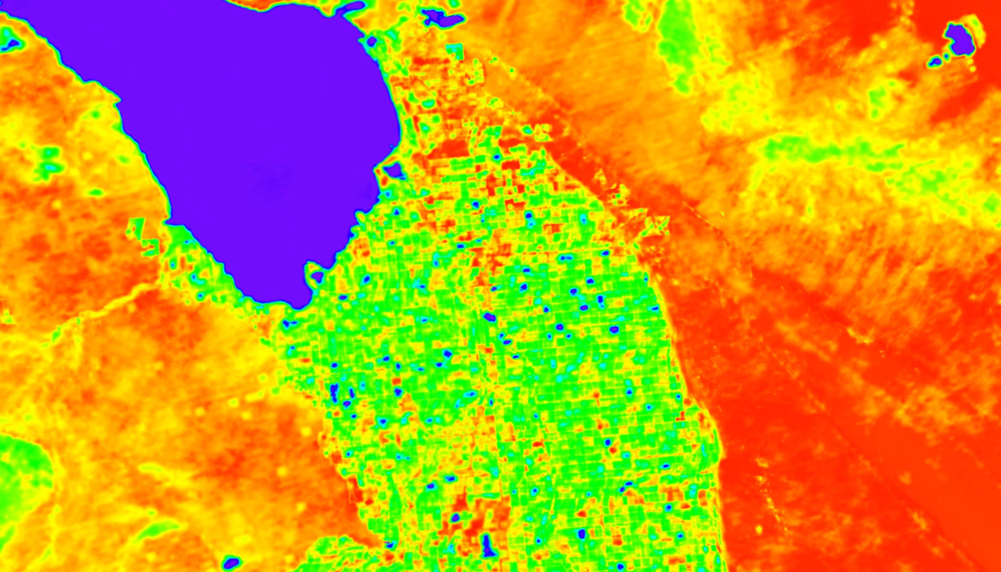 A simulation of ECOSTRESS land surface temperature data around California's Salton Sea (dark blue area, upper left). Cooler areas appear in blue and green, warmer areas are in yellow and red. The region south of the lake that appears green is mostly agricultural fields, and other surrounding areas are desert. ECOSTRESS land surface temperature data will be used to create an evapotranspiration product that can be used to monitor plant stress. Photo & Caption Credit: NASA / JPL-Caltech
