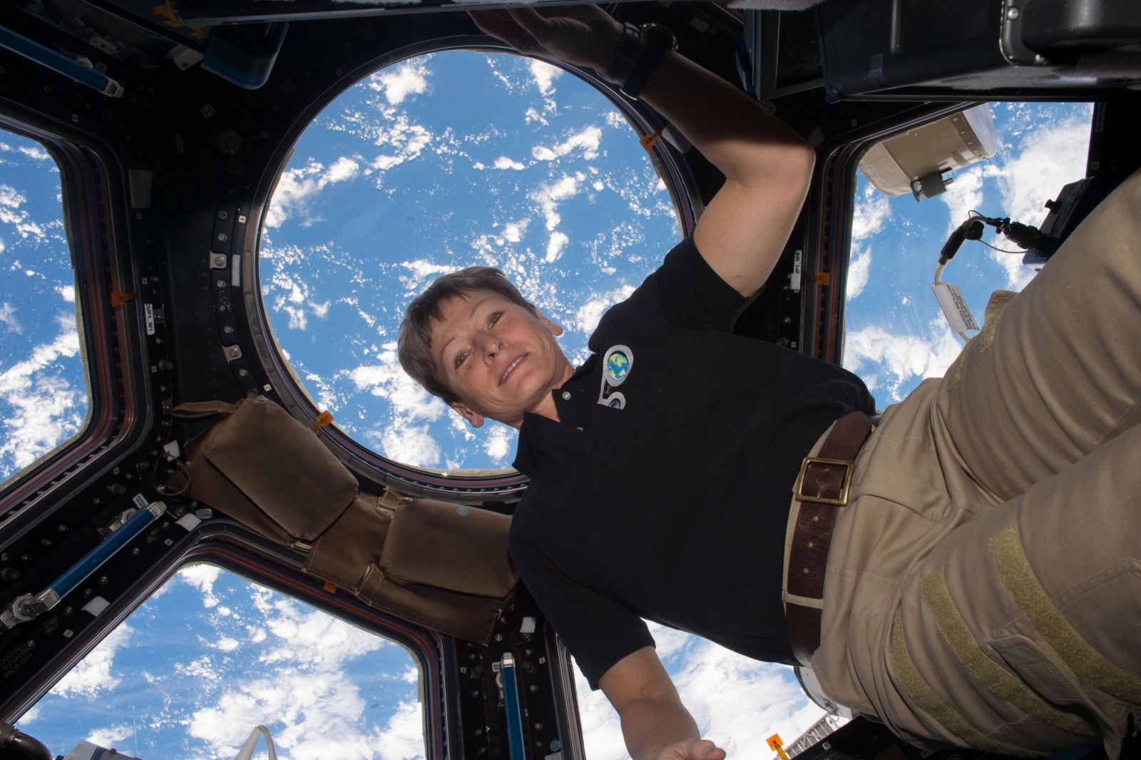 Peggy Whitson floats inside the International Space Station's Cupola window during Expedition 50. Photo Credit: NASA