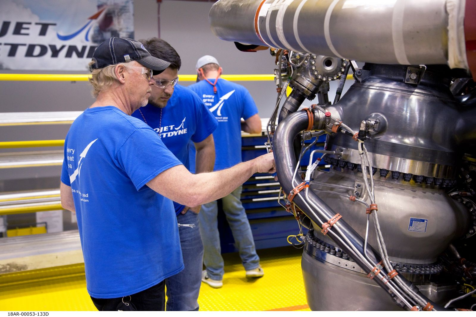 Aerojet Rocketdyne technicians inspect the first AR-22 rocket engine at the Aerojet Rocketdyne facility located at Stennis Space Center. The engine was built for Boeing as part of the U.S. Defense Advanced Research Projects Agency Experimental Spaceplane program. This new Boeing spaceplane, called Phantom Express, is intended to demonstrate a new paradigm for more routine, responsive and affordable space access. Photo courtesy of Aerojet Rocketdyne