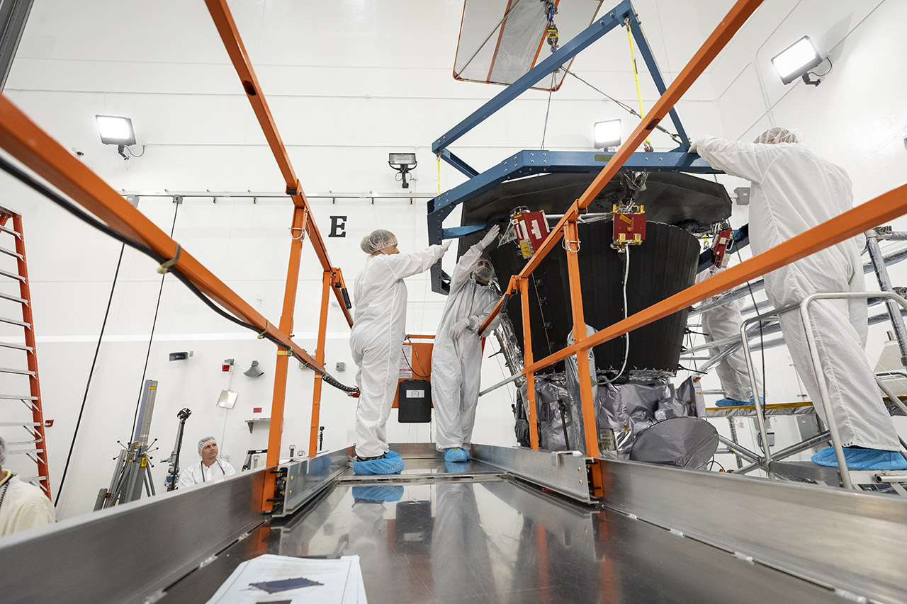 Engineers from the Johns Hopkins Applied Physics Lab install the thermal protection system, or heat shield, on the Parker Solar Probe. Photo Credit: NASA / Johns Hopkins APL
