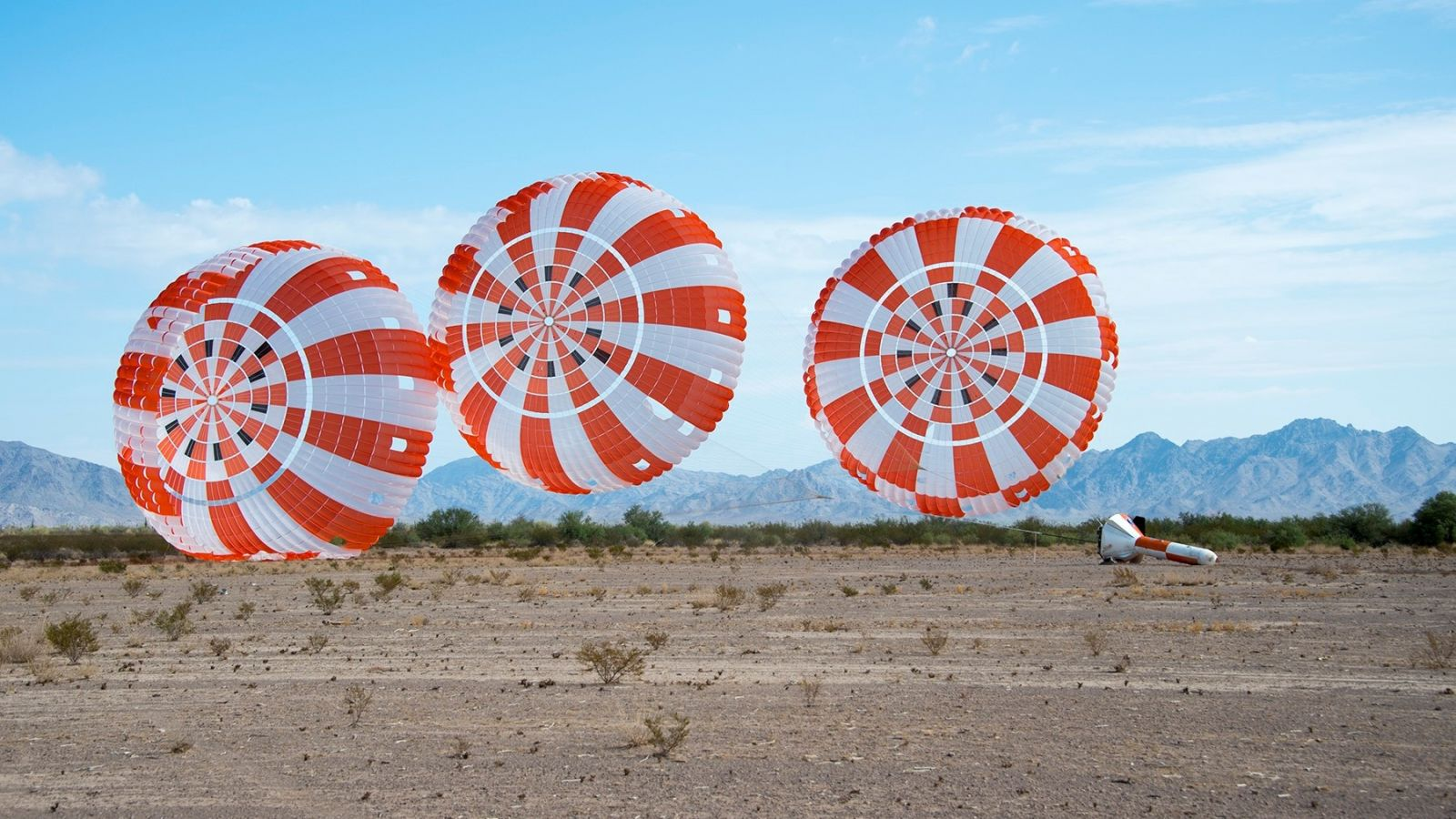 Orion's parachute system completes the seventh drop in a series of eight qualification tests. Photo Credit: NASA