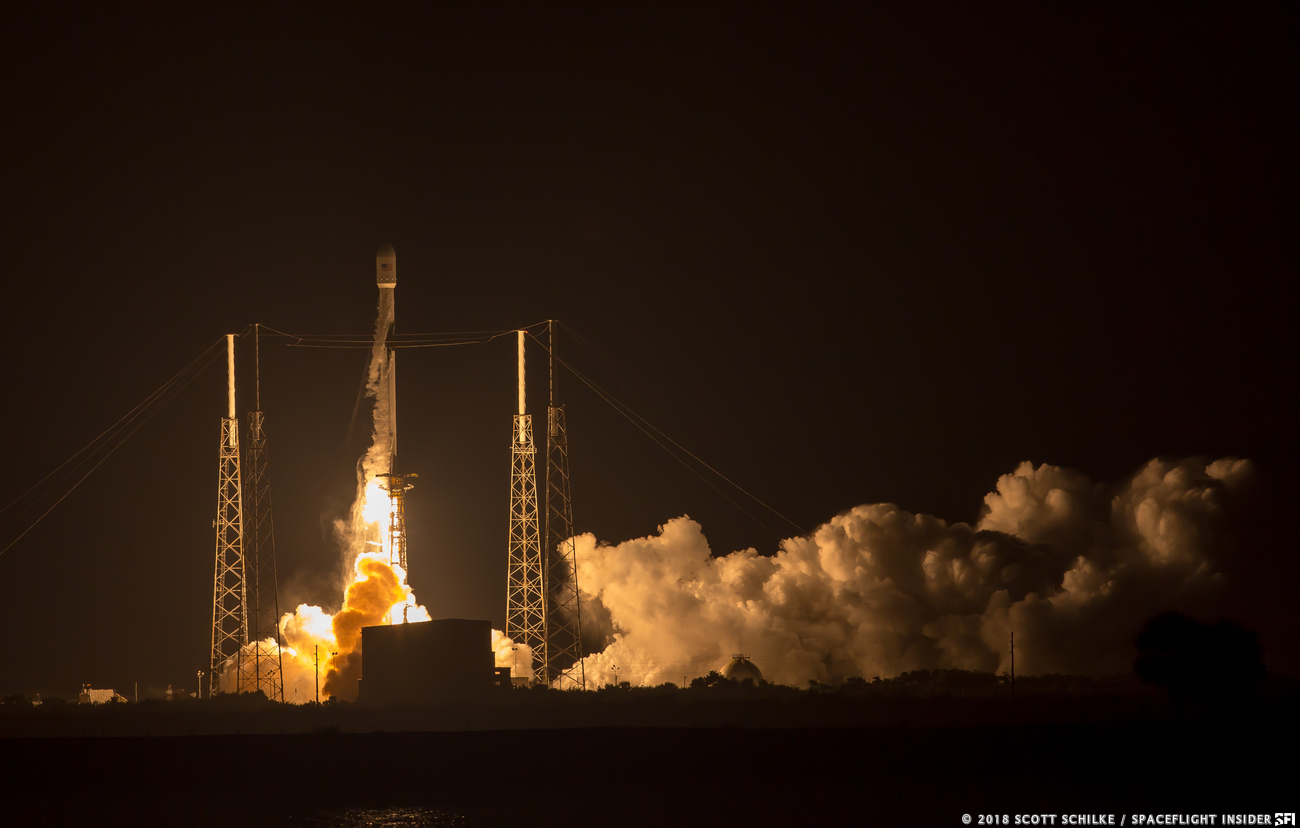 SpaceX's Falcon 9 rocket rises into the night sky to send the Merah Putih communications satellite into orbit. Photo Credit: Scott Schilke / SpaceFlight Insider