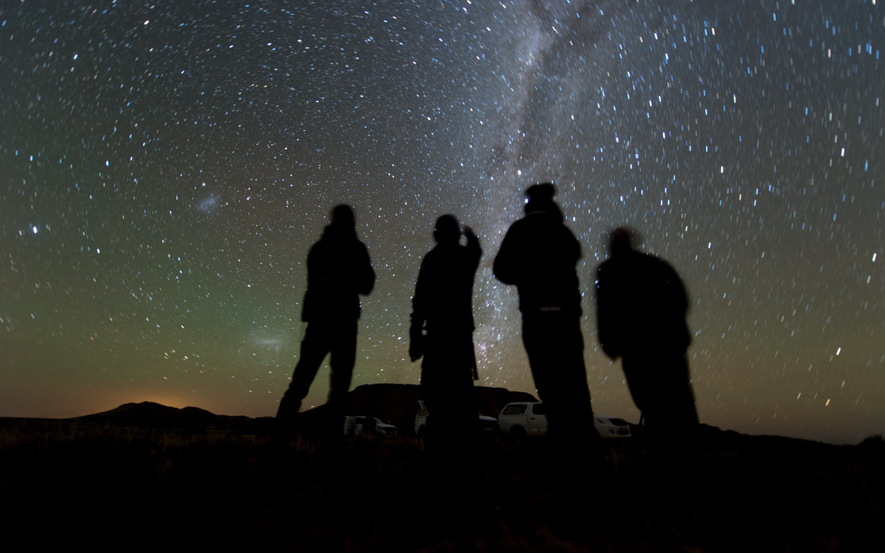 Four members of the observation team scan the sky while waiting for the start of the 2014 MU69 (Ultima Thule) occultation, early on the morning of June 3, 2017. New Horizons team members will attempt similar observations of Ultima on Aug. 4 in Senegal. Photo and Caption Credit: NASA / Johns Hopkins Applied Physics Laboratory / Southwest Research Institute / Southwest Research Institute / Henry Throop