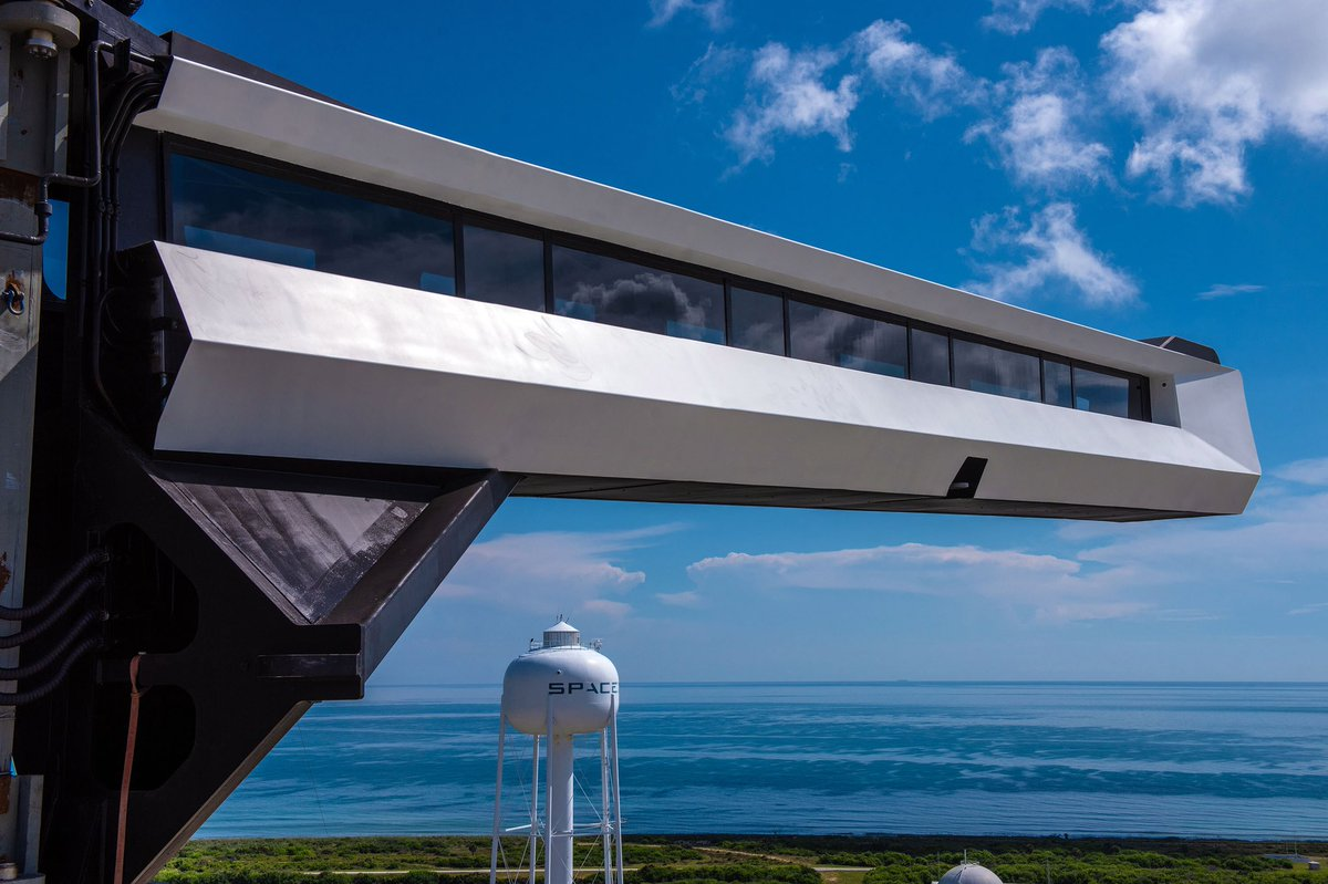 SpaceX's crew access arm extends out from LC-39A's fixed service structure after installation. Photo Credit: SpaceX