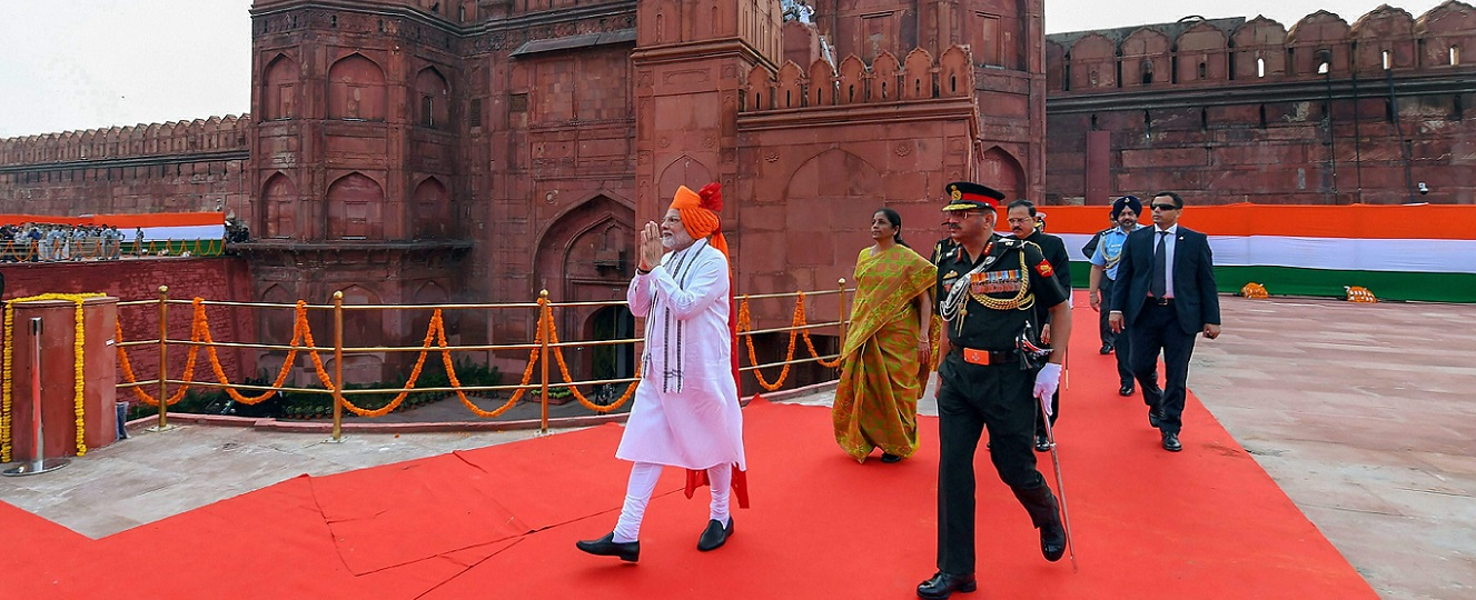 Narendra Modi greets the people as he proceeds towards the dais to address the nation from the ramparts of Red Fort during the 72nd Independence Day function in New Delhi on August 15, 2018.