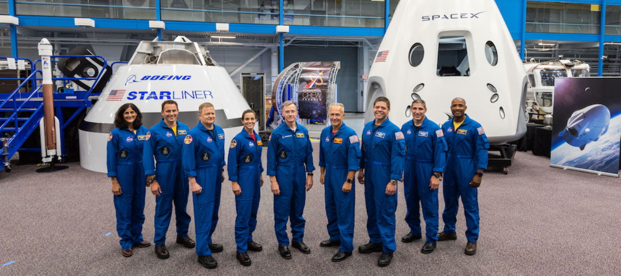 The first crews that will fly under NASA's Commercial Crew Program were announced Aug. 3 at NASA's Johnson Space Center in Houston. From left to right: Sunita Williams, John Cassada, Eric Boe, Nicole Mann, Christopher Ferguson, Douglas Hurley, Robert Behnken, Michael Hopkins and Victor Glover. Photo Credit: NASA