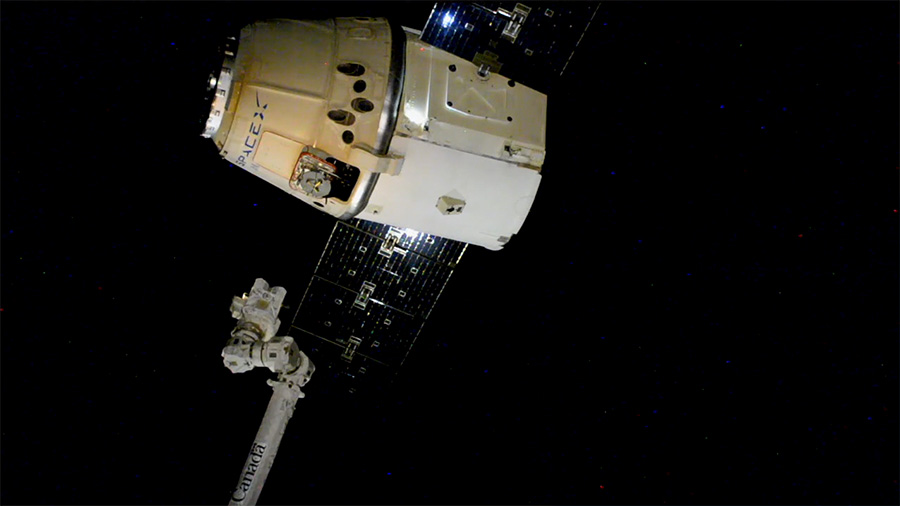 The CRS-15 Dragon capsule is released via the robotic Canadarm2. Photo Credit: NASA