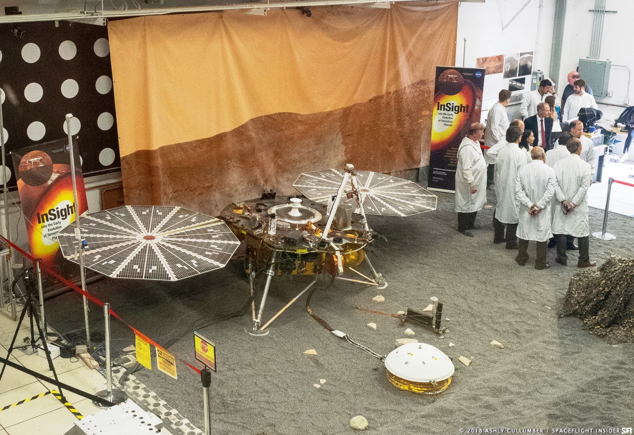 Scientists at NASA's Jet Propulsion Laboratory gather around a model of the Mars InSight lander. Photo Credit: Ashly Cullmber / SpaceFlight Insider