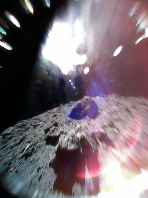 Color image captured by Rover-1A on September 22, 2018, while moving (during a hop) on the surface of asteroid Ryugu.