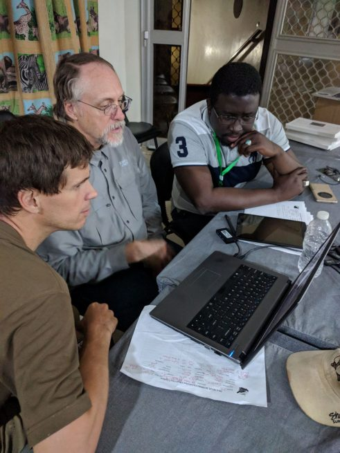Occultation Team Lead Marc Buie, center, gets his first look at the detection of Ultima Thule by stellar occultation in Louga, Sénégal, with Maram Kaire, right, Technical Advisor, Ministry of Higher Education, Research, and Innovation or MESRI in Sénégal, and David Baratoux, left, Lead, African Initiative for Planetary and Space Sciences; Institut de recherche pour le développement (IRD), Université de Toulouse, France. Photo Credit: NASA/Johns Hopkins University Applied Physics Laboratory/Southwest Research Institute/Anne J. Verbiscer