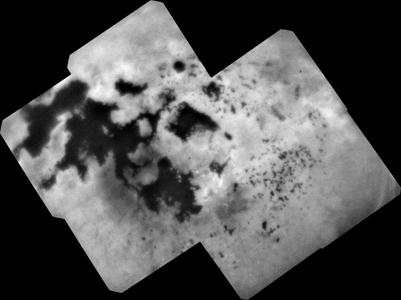 Four days before Cassini's fiery end, onboard cameras snapped this mosaic of photos of the north polar landscape of Titan, which is filled with liquid methane and ethane lakes and seas. Photo Credit: NASA / JPL-Caltech / SSI