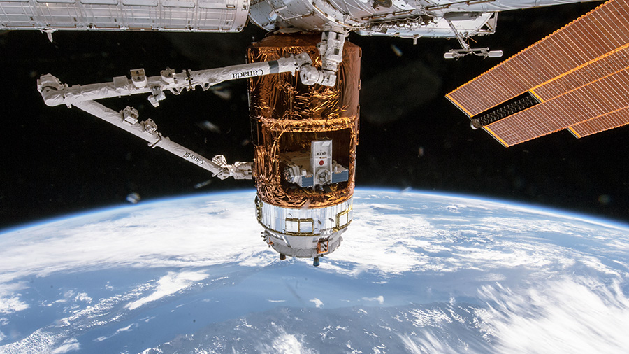 A file photo of a previous Japanese cargo ship berthed to the ISS. Kounotori 7 is set to deliver thousands of pounds of supplies to the outpost, including six giant lithium-ion batteries. Photo Credit: NASA