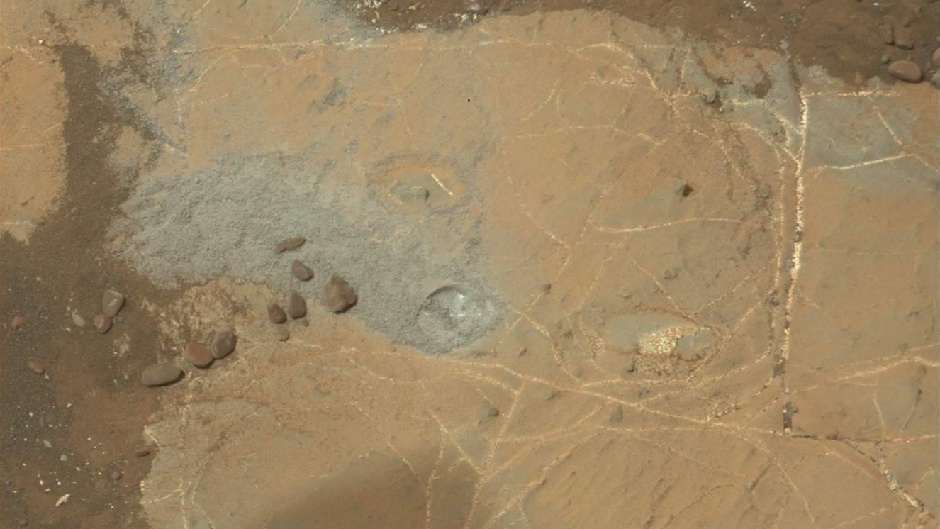 A picture from Curiosity's Mast Camera on Sol 2171 shows a drill hole only 0.16 inches (4 millimeters) deep, which is much less than was anticipated. Photo Credit: NASA