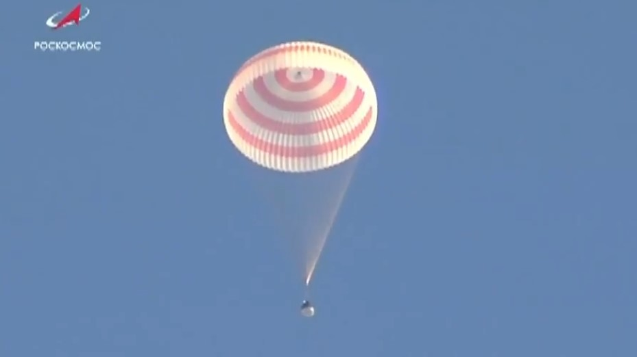 Soyuz MS-08 descends beneath its main parachute. Russian cosmonaut Oleg Artemyev and NASA astronauts Drew Feustel and Ricky Arnold returned to Earth Oct. 4, 2018, after 197 days in space. Photo Credit: NASA TV