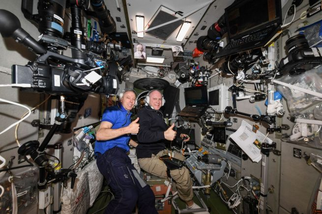 Expedition 56 Commander and NASA astronaut Drew Feustel, left, and Russian cosmonaut Oleg Artemyev of Roscosmos inside the Zvezda service module practicing Soyuz descent procedures several days before landing. Photo Credit: NASA