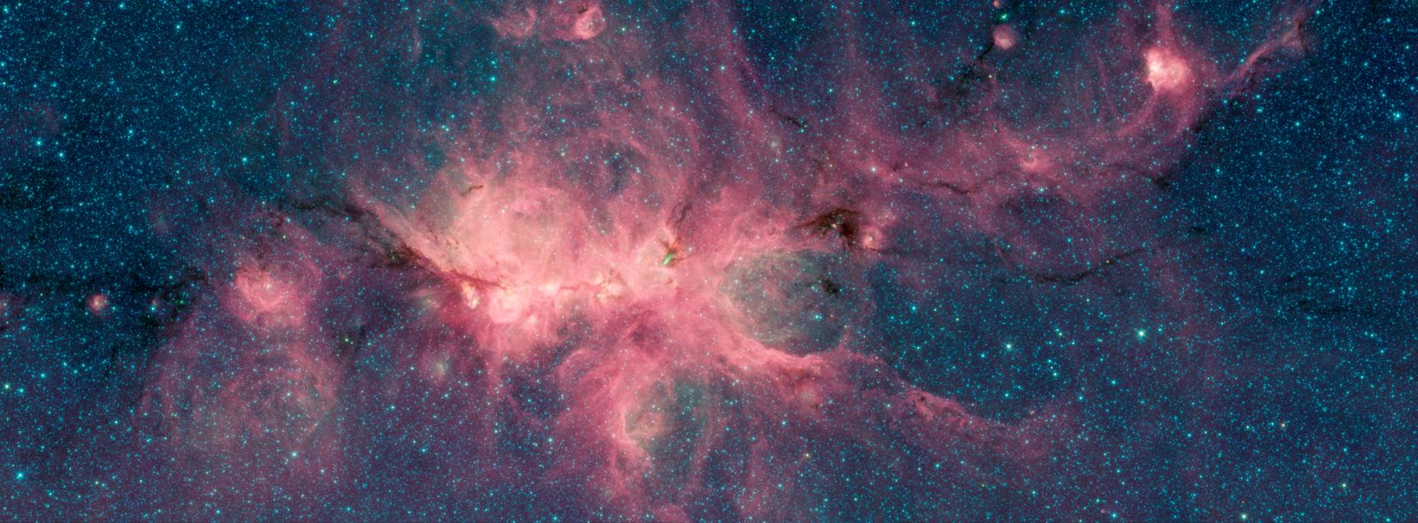 The Cat's Paw Nebula, imaged here by NASA's Spitzer Space Telescope using the IRAC instrument, is a star-forming region inside the Milky Way Galaxy. The dark filament running through the middle of the nebula is a particularly dense region of gas and dust. Image Credit: NASA/JPL-Caltech