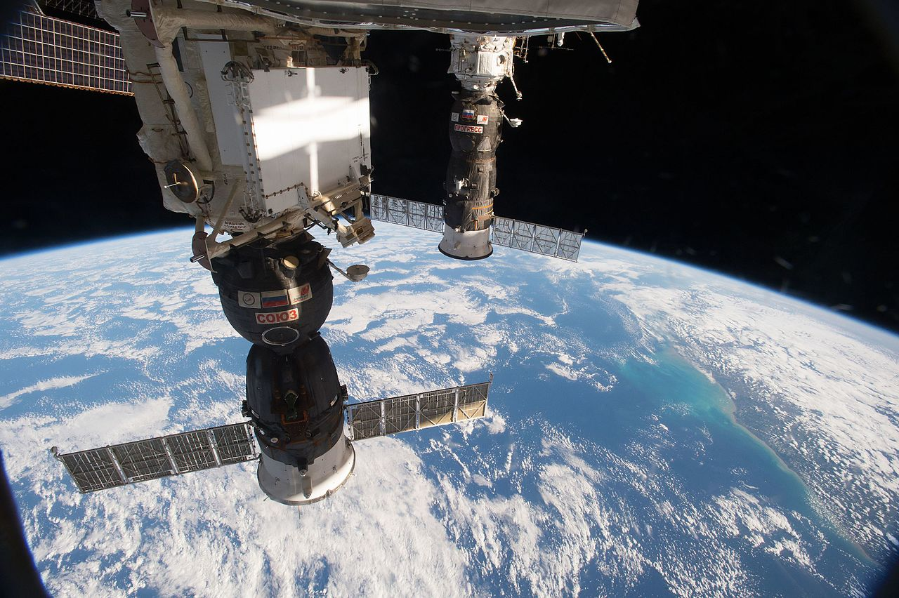 ISS-48_Soyuz_MS-01_and_Progress_MS-03_docked_to_ISS_over_Brazil