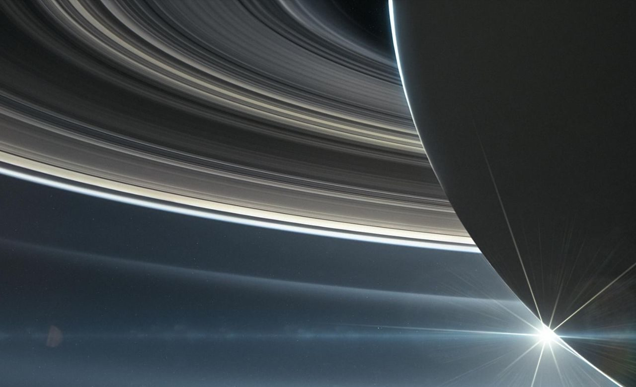 This illustration shows NASA's Cassini spacecraft in orbit around Saturn. Image Credit: NASA/JPL-Caltech