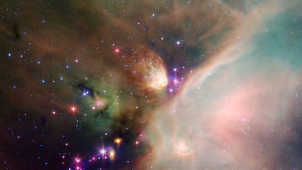 Spitzer Catches Young Stars in their Baby Blanket of Dust. Image Credit: NASA/JPL-Caltech