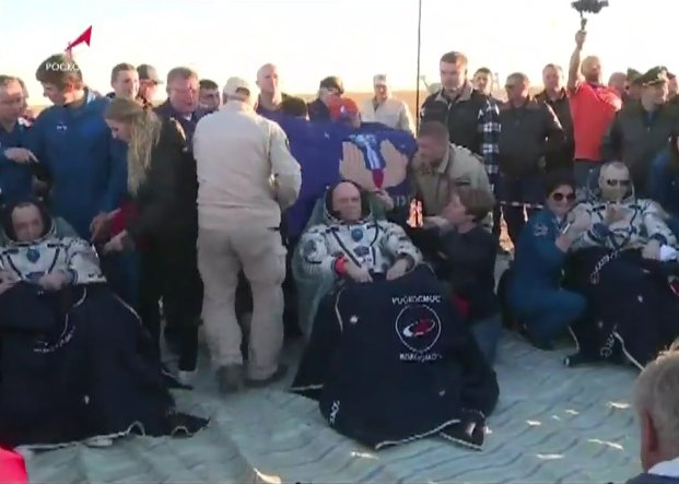 The Soyuz MS-08 crew sits in their reclining chairs after being extracted by Russian recovery teams. Photo Credit: NASA TV