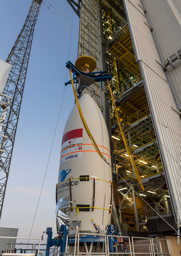 The upper composite with the Mohammed VI–B satellite is hoisted to the upper levels of Vega's mobile gantry. Photo Credit: Arianespace