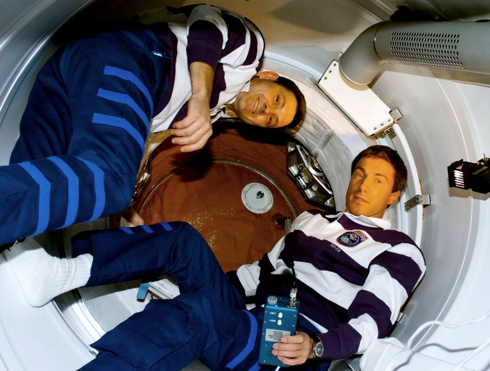 NASA astronaut Bob Cabana, left and Russian cosmonaut Sergei Krikalev prepare to open the hatch to the Zarya module during STS-88. Photo Credit: NASA