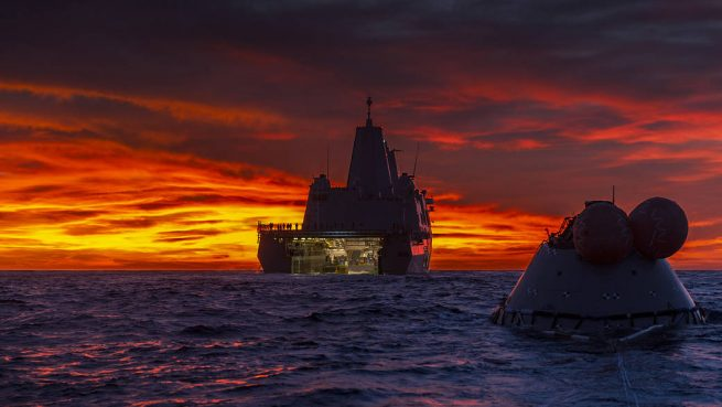 On Nov. 1, 2018, the U.S.S. John P Murtha recovered a test version of the Orion capsule in the Pacific Ocean. Photo Credit: Tony Gray / NASA
