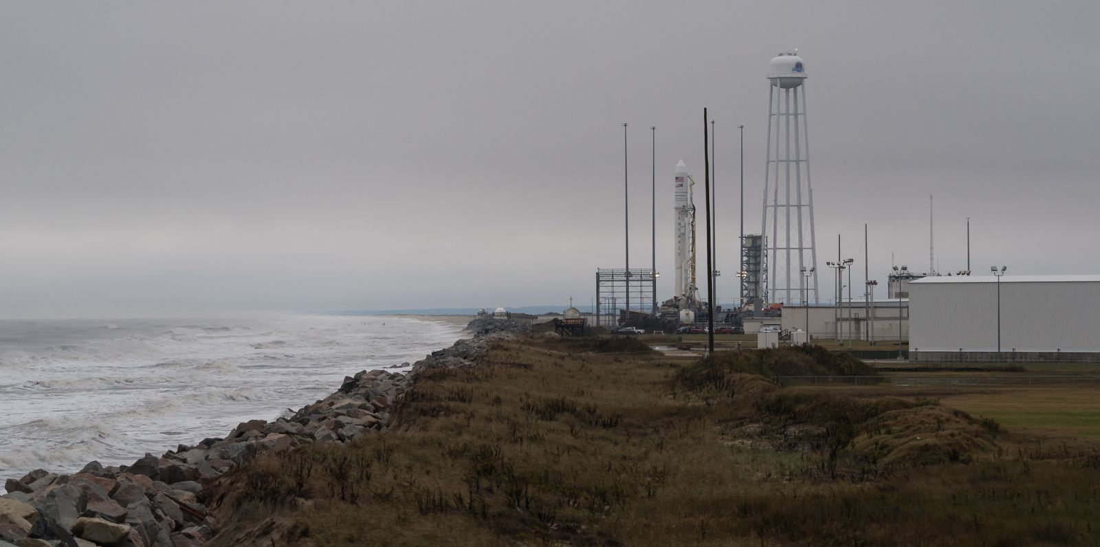 The Antares 230 rocket was rolled to the pad on a rainy Nov. 13, 2018. Weather for the Nov. 15, 2018, launch attempt isn't expected to be much better with only a 30 percent chance of acceptable liftoff conditions. Photo Credit: Joel Kowsky / NASA