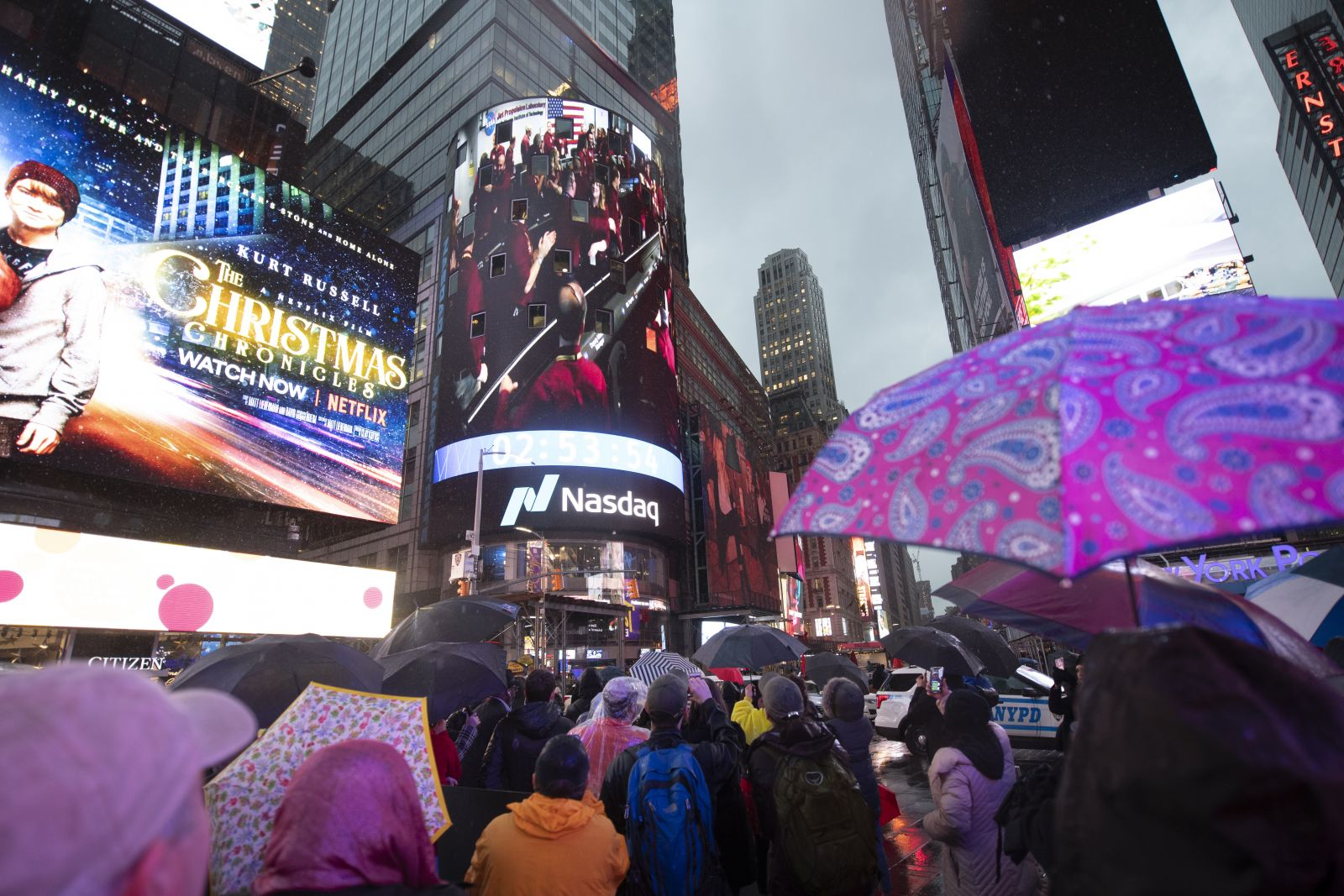 Spectators in Times Square watch the video board of the Nasdaq MarketSite showing the live NASA TV broadcast as NASA InSight team members celebrate inside the Mission Support Area of NASA's Jet Propulsion Laboratory after receiving confirmation the lander successfully touched down on the surface of Mars, Monday, Nov. 26, 2018 in Times Square in New York City. Photo & Caption Credit: Joel Kowsky / SpaceFlight Insider