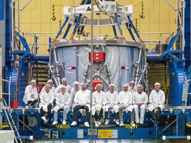 The Airbus team poses in front of the European-built service module for NASA's Orion spacecraft before it was shipped from Germany to Kennedy Space Center. Photo Credit: Rad Sinyak / NASA