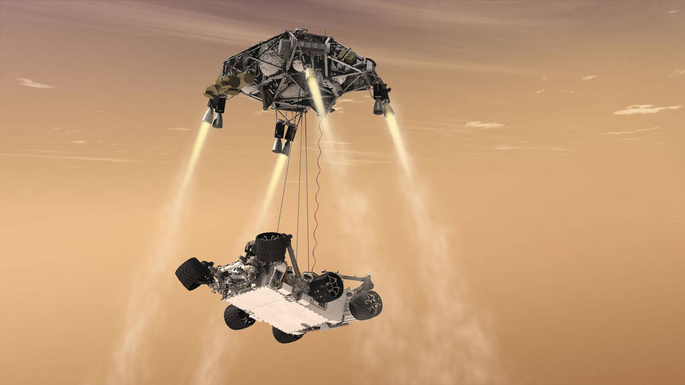 An artist's rendering of the Curiosity rover landing using the sky-crane maneuver to touch down on the surface of the Red Planet. The Mars 2020 rover is expected to use a similar method. Image Credit: NASA/JPL