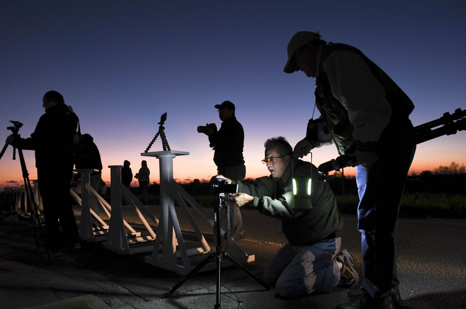 SpaceFlight Insider's Mike Howard sets a remote camera station in the early hours at Kennedy Space Center. Each station costs several hundred dollars and could be lost should an accident occur. Photo Credit: Craig Bailey/FLORIDA TODAY