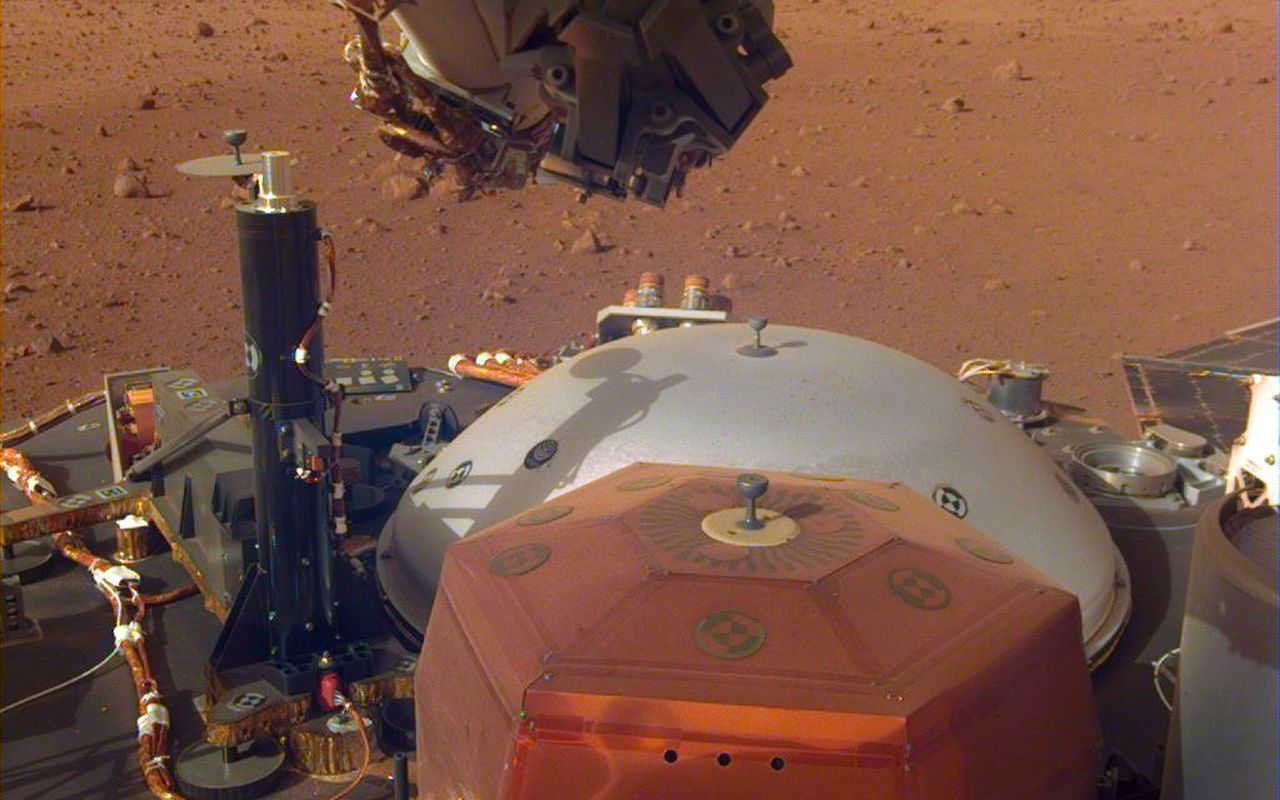 This image from InSight's robotic-arm mounted Instrument Deployment Camera shows the instruments on the spacecraft's deck, with the Martian surface of Elysium Planitia in the background. The image was received on Dec. 4, 2018 (Sol 8). Image Credit: NASA/JPL-Caltech
