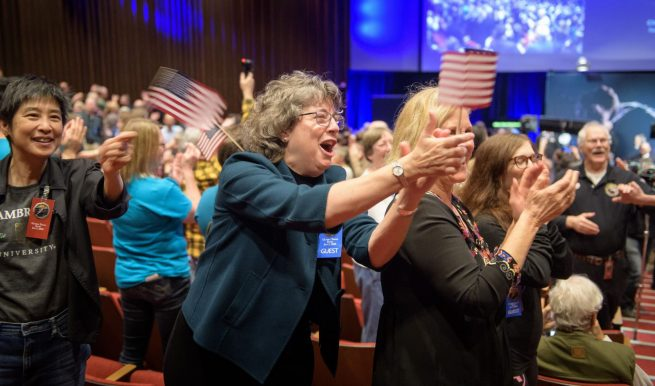 In the post-flyby press conference, attendees congratulate the New Horizons team for the successful operation. Photo Credit: Bill Ingalls / NASA