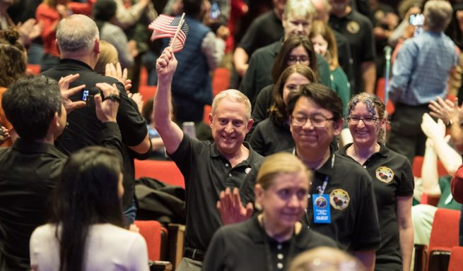 New Horizons Principal Investigator Alan Stern celebrates with other team members before the post-flyby press conference. Photo Credit: Joel Kowsky / NASA