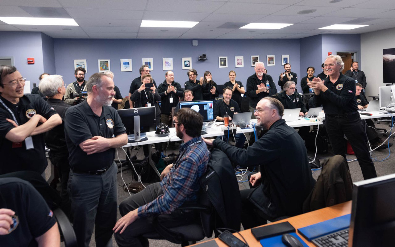 Photo from mission headquarters taken after it was confirmed that New Horizons had completed a successful flyby. Photo Credit: Henry Throop & Ed Whitman