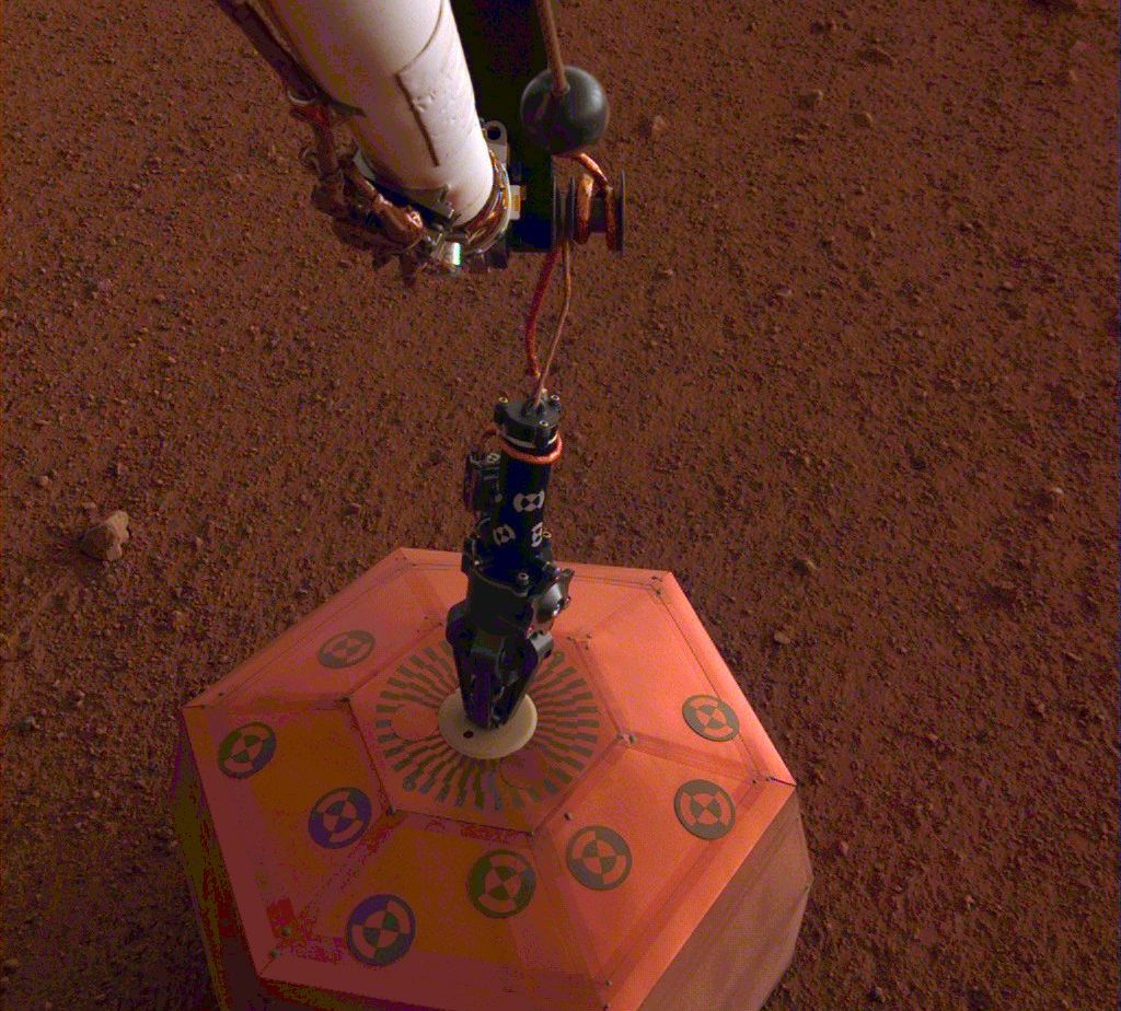 InSight deploys SEIS, the Seismic Explorations for Interior Structure, onto the surface of Mars on Dec. 19, 2018. Photo credit: NASA/JPL-Caltech