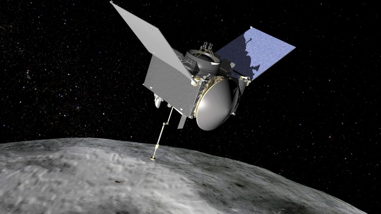 An artist's rendering of NASA's Origins, Spectral Interpretation, Resource Identification, Security-Regolith Explorer (OSIRIS-REx) spacecraft at Bennu. Image Credit: NASA Goddard Space Flight Center