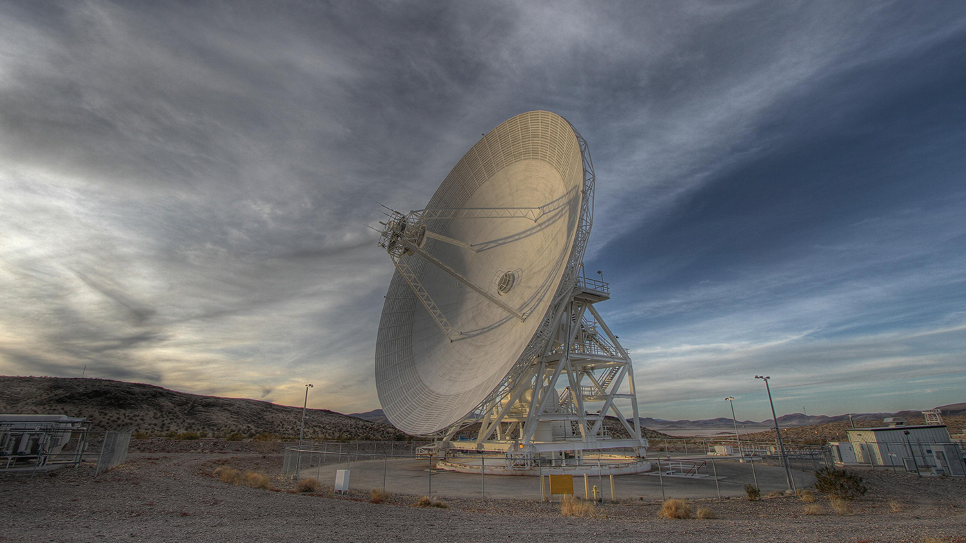 A 111.5-foot (34-meter) antenna located at the Goldstone Deep Space Communications Complex in the Mojave Desert tracks a spacecraft. In order to send commands to Opportunity, NASA uses the Deep Space Network, which includes three locations around Earth with giant antennas. Photo Credit: NASA/JPL-Caltech