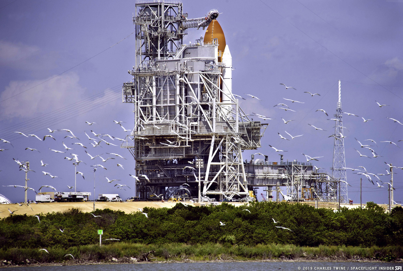 Birds take to the skies in front of Kennedy Space Center's Launch Complex 39A. Photo Credit: Charles Twine / SpaceFlight Insider