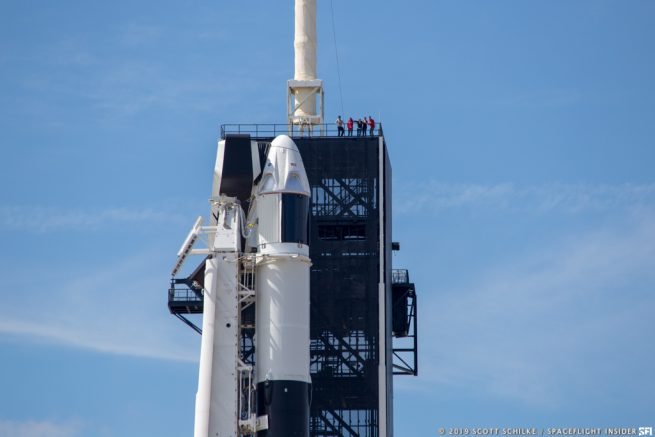 The Demo-1 Crew Dragon sits atop the Falcon 9 rocket in the hours before launch. Photo Credit: Scott Schilke / SpaceFlight Insider