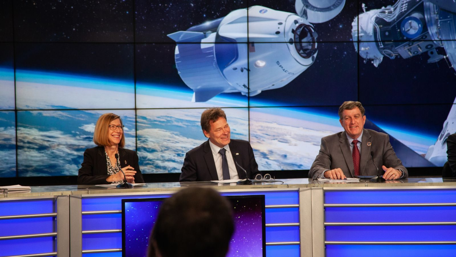 SpaceX vice president for mission assurance, Hans Koenigsmann (center), during a pre-flight press conference before the Dragon Demo-1 mission in February 2019. According to a report by CNBC, he plans to retire. Credit: NASA