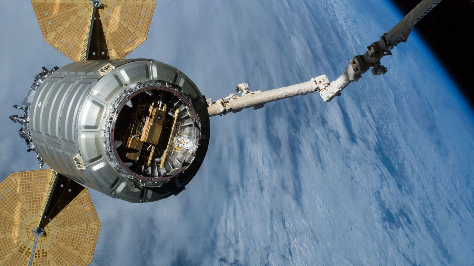 "The NG-10 Cygnus was unberthed and released from the International Space Station on Feb. 8, 2019. Since then it performed a post-ISS mission to deploy several CubeSats, including some via a ""SlingShot"" deployer, seen here attached to the spacecraft's hatch. Photo Credit: NASA"