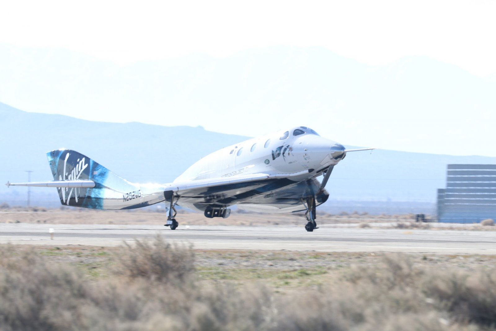 SpaceShipTwo glides back to the runway following its fifth power flight and second trip to space. Photo Credit: Virgin Galactic