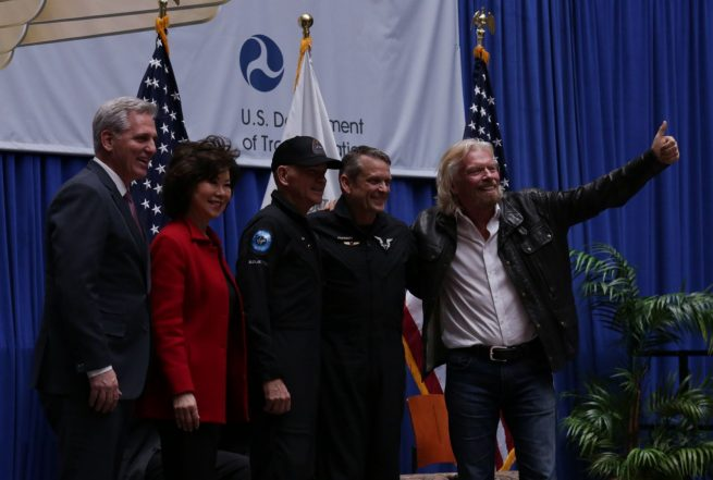Virgin Galactic pilots Mark Stucky and CJ Sturckow were awarded commercial astronaut wings on Feb. 7, 2019. From left to right: U.S. House of Representatives Minority Leader Kevin McCarthy, Secretary of Transportation Elaine Chao, CJ Sturckow, Mark Stucky and Richard Branson. Photo Credit: Credit: FAA Office of Communications