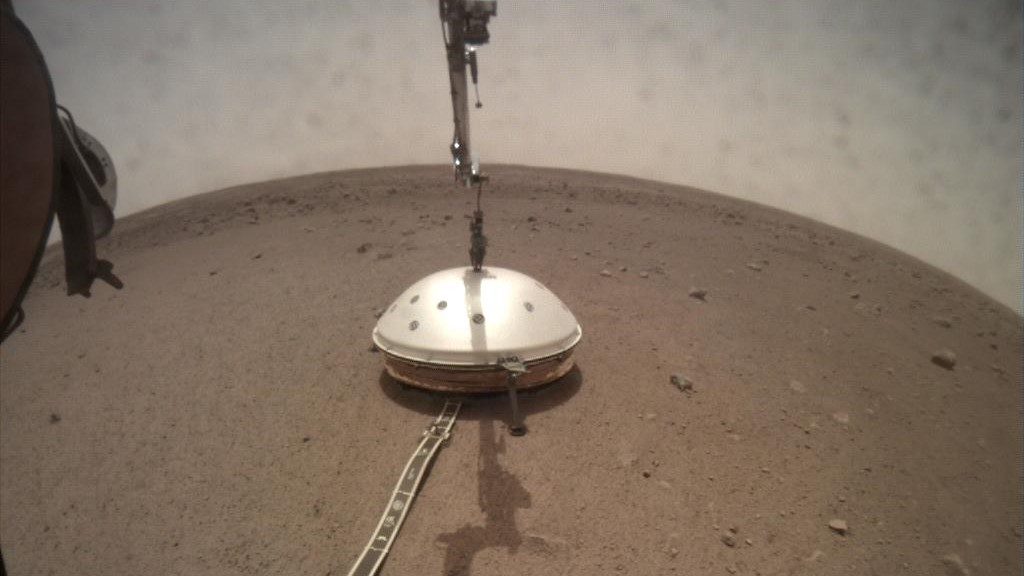 NASA's InSight lander deployed its Wind and Thermal Shield on sol 66 -- Feb. 2, 2019. The shield covers the lander's seismometer, which was set down onto the Martian surface on Dec. 19, 2018. Over 2.5 years later, data from the seismometer have shown Mars' center to be molten. Credit: NASA/JPL-Caltech