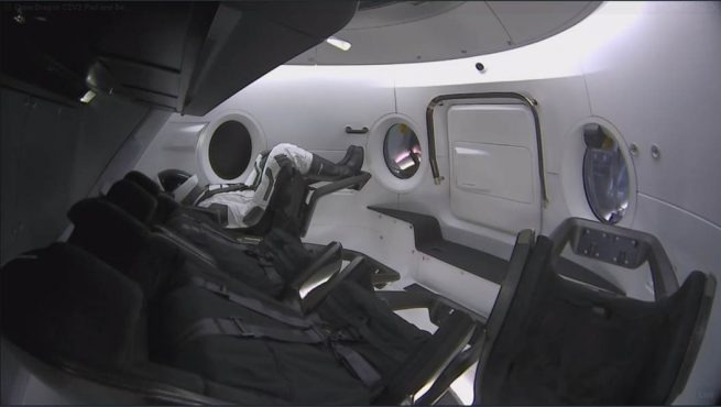 SpaceX's ATD named Ripley sits in the far left seat in this image. It will stay there for the whole mission to collect various data points regarding cabin conditions during ascent, flight and landing. Photo Credit: Elon Musk / SpaceX